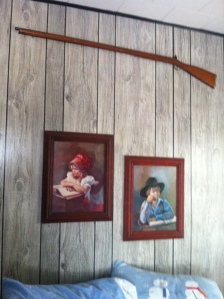 Only at my parents house, would you sleep beneath sweet photos and a gun.